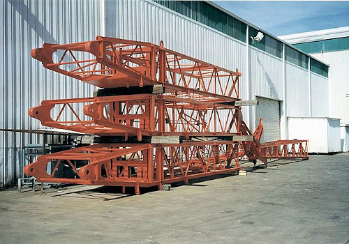 A set of crane booms fabricated by Myrex Industries in their Houston Texas facility